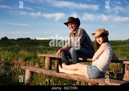 couple of young people admire the sunset in the spring evening - Stock Photo