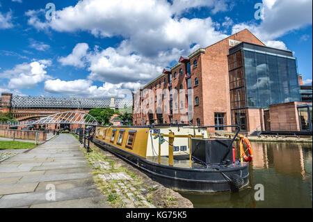 Barge moored on the Bridgewater Canal in the centre of Manchester, UK - Stock Photo