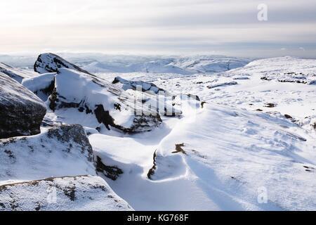Snow covered tor landscape in winter, Kinder Scout, Derbyshire, England, UK - Stock Photo
