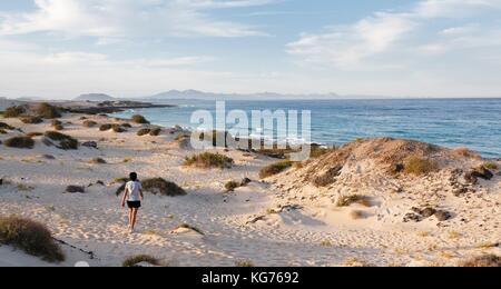 nude woman on cofete beach on fuerteventura stock photo