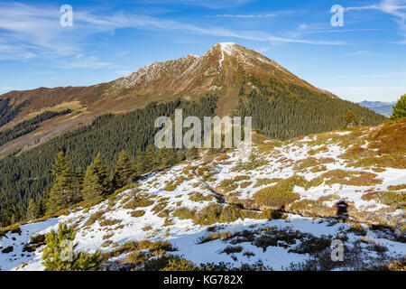 alpine landscape with first snow in late autumn - Stock Photo