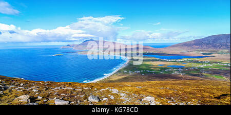 birds eye aerial view from top of a mountain in achill island. beautiful irish landscape and seascape of achill - Stock Photo