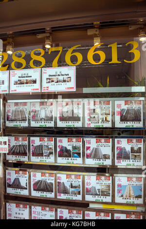 Estate Agent Window Display, Hong Kong - Stock Photo