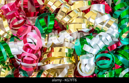 background texture full frame of bright multicolored Christmas curling ribbon - Stock Photo