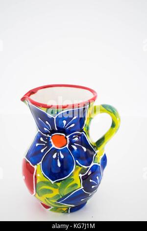 a close up of a flower print ceramic serving jug - Stock Photo