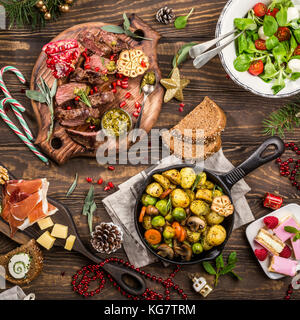 Christmas themed dinner table - Stock Photo