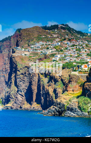 Village hanging in a cliff. - Stock Photo