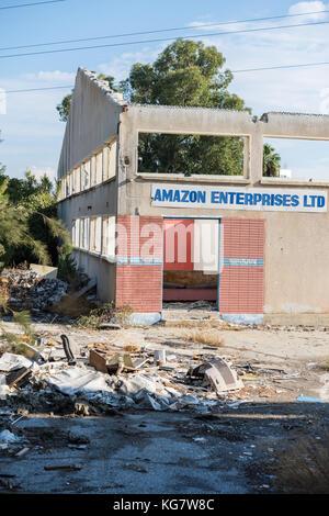 Amazon Enterprises LTD. sign on abandoned industrial building in Larnaca, Cyprus - Stock Photo