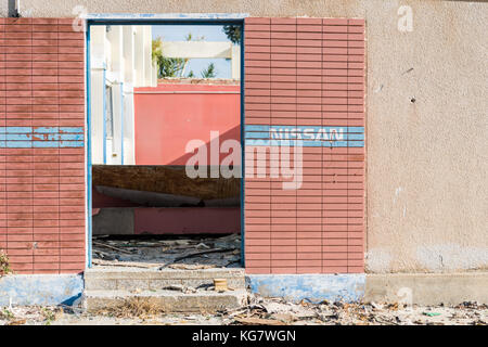 Nissan sign on abandoned industrial building in Larnaca, Cyprus - Stock Photo