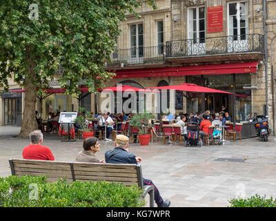BORDEAUX, FRANCE:  People sitting outside Cafe de la Poste in the pretty Place Saint-Projet Square - Stock Photo
