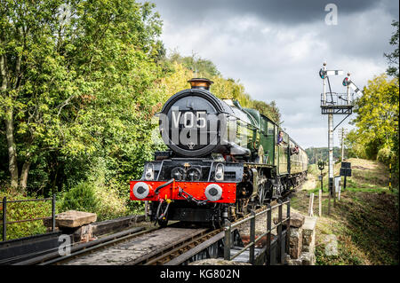 GWR King Class 4-6-0 No 6024 King Edward I steam locomotive approaches Hampton Loade Station on the Severn Valley - Stock Photo