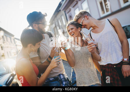 Group of young happy friends having fun time - Stock Photo