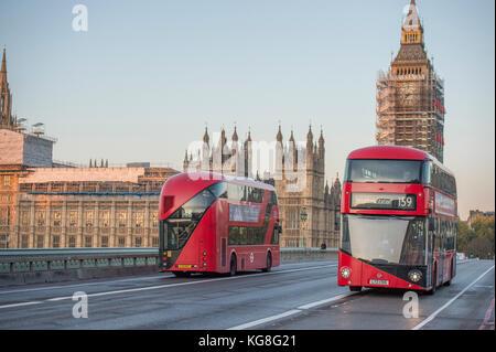 Westminster Bridge, London, UK. 5 November, 2017. Two New Routemaster buses  cross Westminster Bridge in opposite - Stock Photo