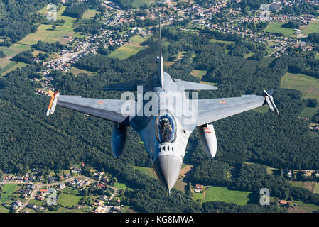 Air-to-air with a F-16 Fighting Falcon fighter jet of the Belgian Air Force. - Stock Photo