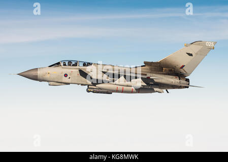 A Panavia Tornado GR4 multirole fighter jet of the Royal Air Force during an aerial refueling mission over the North - Stock Photo
