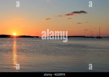 Sun setting behind a small island in the Gulf of Mexico, Islamorada, Florida Keys, Florida, USA - Stock Photo