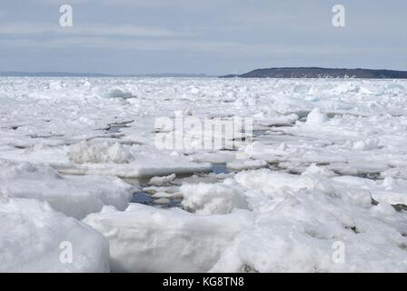 Pack Ice in the bay, Conception Bay South, Newfoundland Labrador - Stock Photo