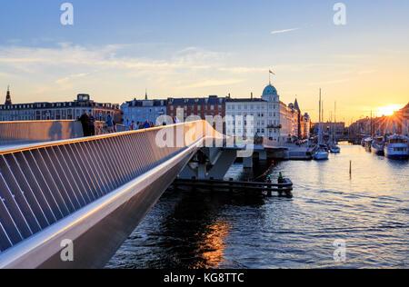 Inderhavnsbroen -  the Inner Harbour pedestrian and cyclist bridge connecting Nyhavn and Christianshavn, Copenhagen, - Stock Photo