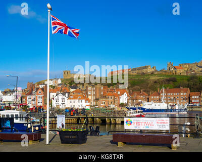 New Quay Wharf in Whitby harbour North Yorkshire UK in fine sunny autumn weaher with a Union Flag flying on the - Stock Photo