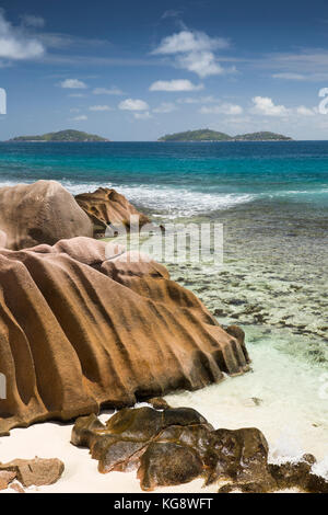 The Seychelles, La Digue, Anse Formis, east coast, rocky shore, beach and shallow lagoon opposite Felicite island - Stock Photo