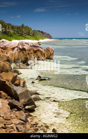 The Seychelles, La Digue, Anse Formis, east coast, rocky shore, beach and shallow lagoon - Stock Photo