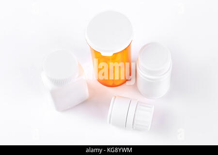 Pills in transparent yellow container. - Stock Photo