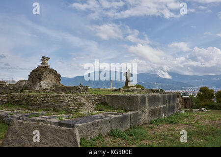 Pompeii ruins exhibited after archaeological excavations. Modern sculpture by the sculptor Igor Mitoraj overlooking - Stock Photo