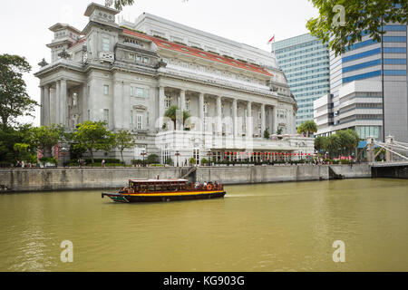 The skyline and cityscape along Singapore River in Singapore - Stock Photo