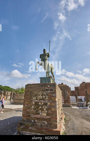 Pompeii ruins exhibited after archaeological excavations. Modern sculptures placed around the site by the sculptor - Stock Photo
