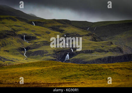 Icelandic Landscape with fog mountains with and small waterfalls - Stock Photo