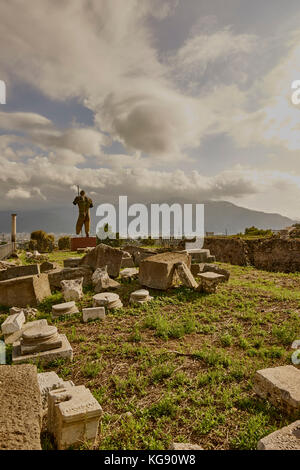 Looking out over modern Pompeii. Ruins on view after archaeological excavations. Modern sculptures by the sculptor - Stock Photo