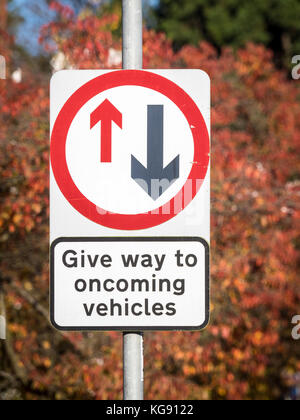 Give Way to Oncoming Vehicles - UK Road Sign - Stock Photo