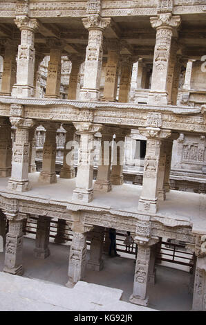 Carved idols on the inner wall and pillars of Rani ki vav, an intricately constructed stepwell on the banks of Saraswati - Stock Photo