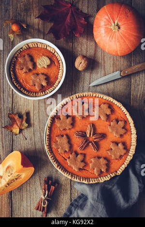 Homemade Pumpkin pie for Thanksgiving dinner on wooden table. Top view. Autumn food, Thanksgiving day food. Vertical, - Stock Photo