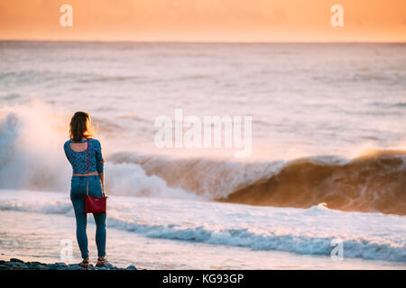 Batumi, Adjara, Georgia - September 7, 2017: Young Woman Girl Looking At Sea Ocean At Sunset Or Sunrise - Stock Photo