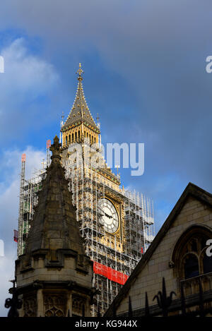 Scaffolding enveloping Big Ben Elizabeth Tower Palace of Westminster Houses of Parliament for restorations renovations - Stock Photo