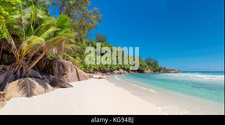 Untouched beautiful beach on tropical island - Stock Photo