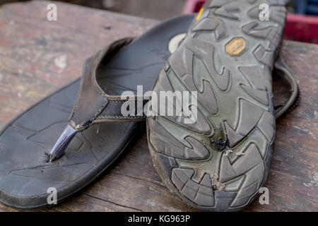 The Blue City - Having my sandal repaired - Stock Photo