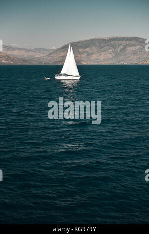 Sailboat sailing in Ionian sea - Stock Photo