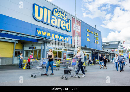 Walking with shopping carts to the entrance of GeKas in Ullared, September 3, 2017 - Stock Photo