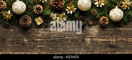 Christmas Background, Fir Tree Branches With Pine Cones, Xmas Baubles and Decorations On Wooden Background, Festive - Stock Photo