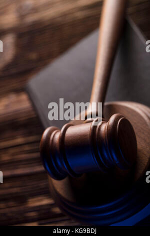 Law and justice theme. Mallet of judge. Legal code. Wooden table. Top view. - Stock Photo