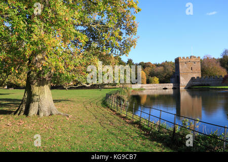 Autumn trees in the grounds of Broughton Castle near Banbury, Oxfordshire - Stock Photo
