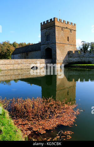 Autumn trees in the grounds at Broughton Castle near Banbury, Oxfordshire - Stock Photo