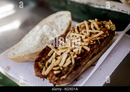 Enjoying a choripan - Stock Photo