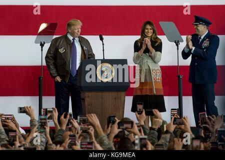 Fussa, Japan. 05th Nov, 2017. U.S President Donald Trump puts on a Air Force flight jacket presented him by Lt. - Stock Photo