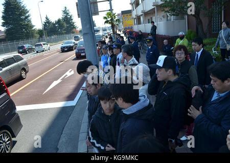 Tokyo, Japan. 5th Nov, 2017. People await outside the Yokota Air Base entran during the arrival of US President - Stock Photo