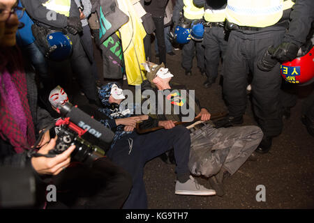 London, United Kingdom. 05th Nov, 2017. Million Mask March 2017 takes place in central London. Protesters block - Stock Photo