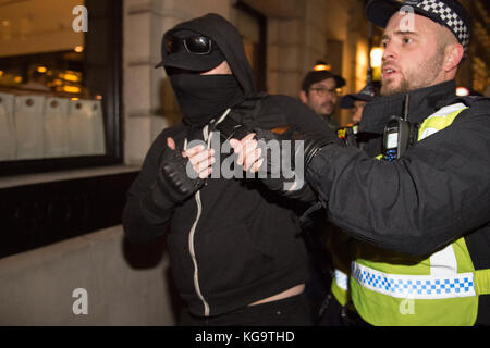 London, United Kingdom. 05th Nov, 2017. Million Mask March 2017 takes place in central London. A protester is arrested. - Stock Photo