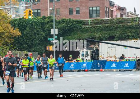 New York, USA. 5th Nov, 2017. Garbage and sand trucks were used to barricade route and protect runners in the New - Stock Photo